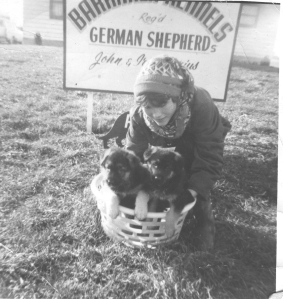 An old photo of me and a basket of puppies.